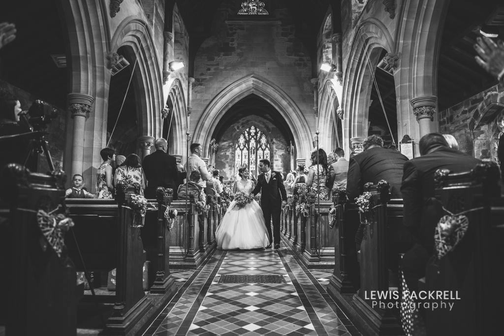 Un-plugged wedding image of camera in church