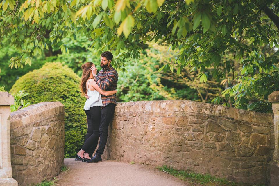Swansea pre-wedding photo shoot the couple on bridge