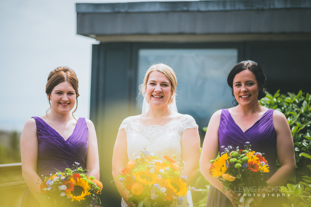 bride and bridesmaids on morning ahead of wedding