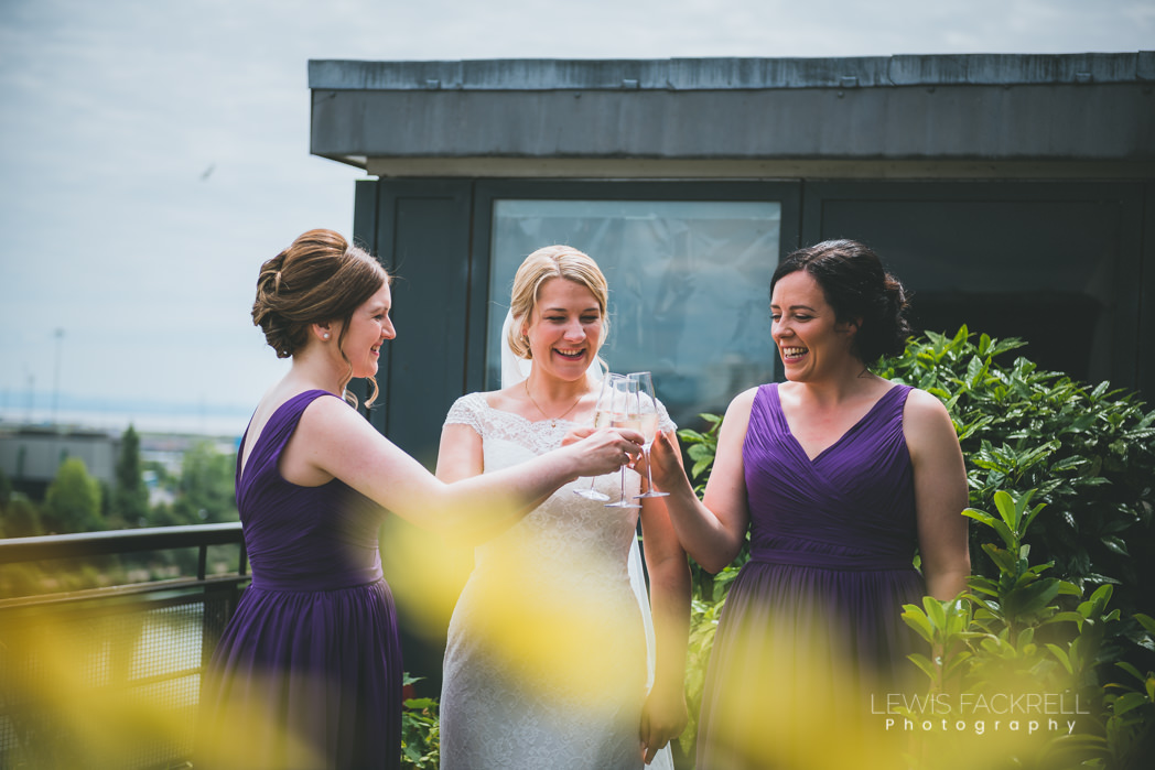 bridesmaids and bride toast in garden