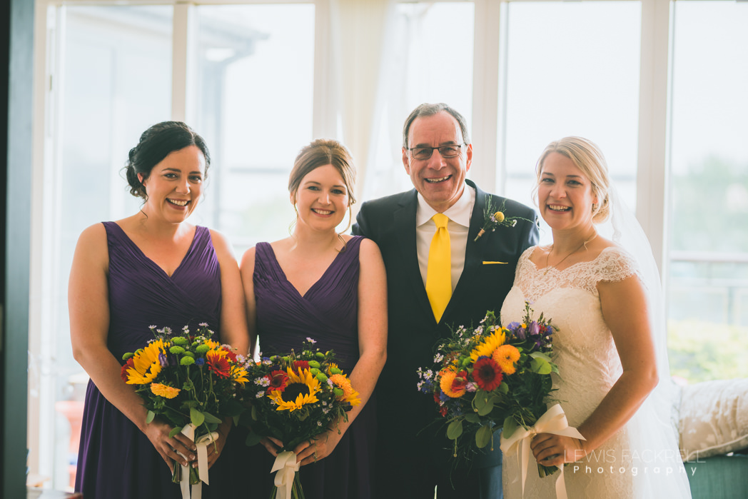 bride bridesmaids and father of the bride