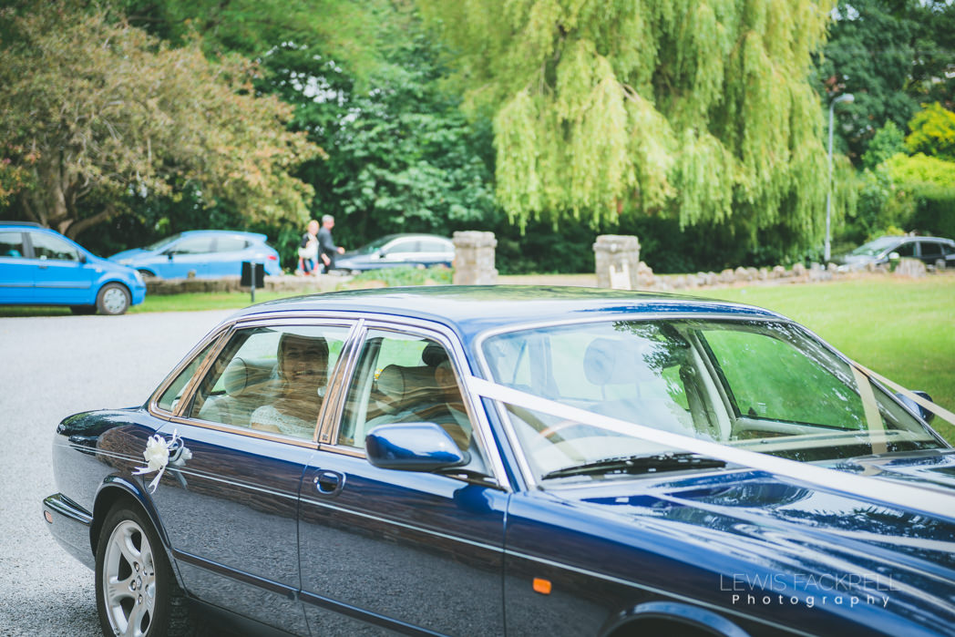 wedding car arriving at church ceremony