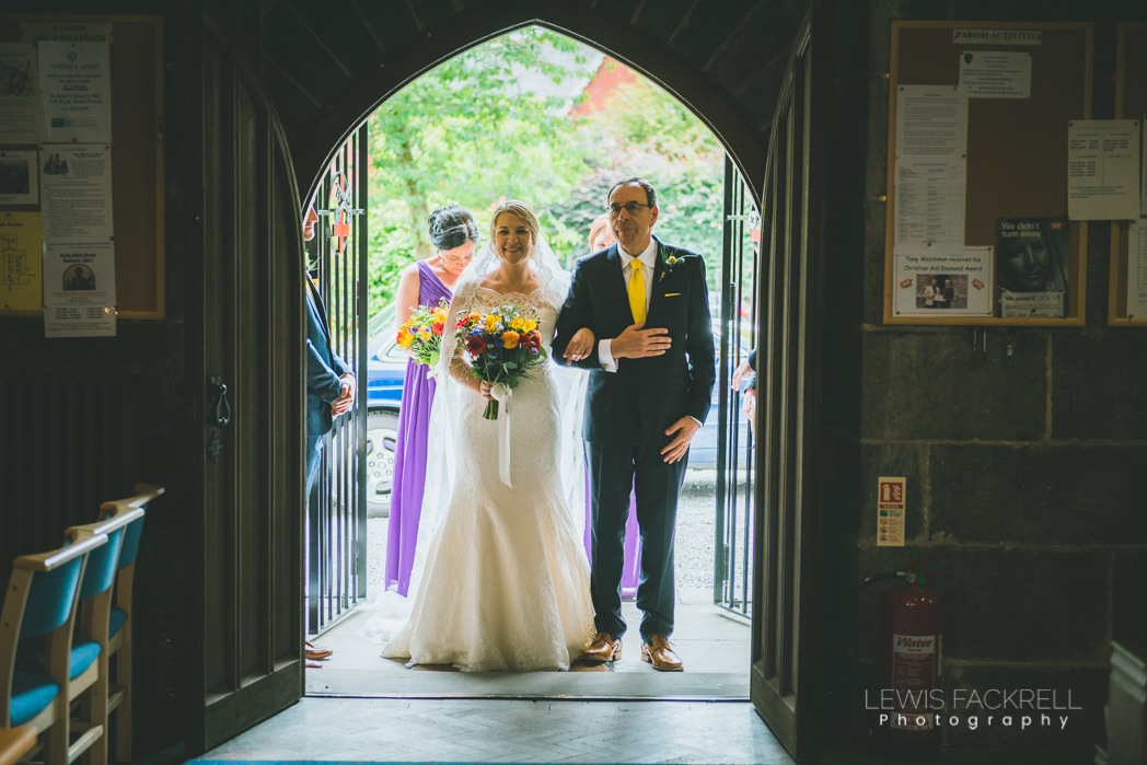 bride and father of the bride entering the church