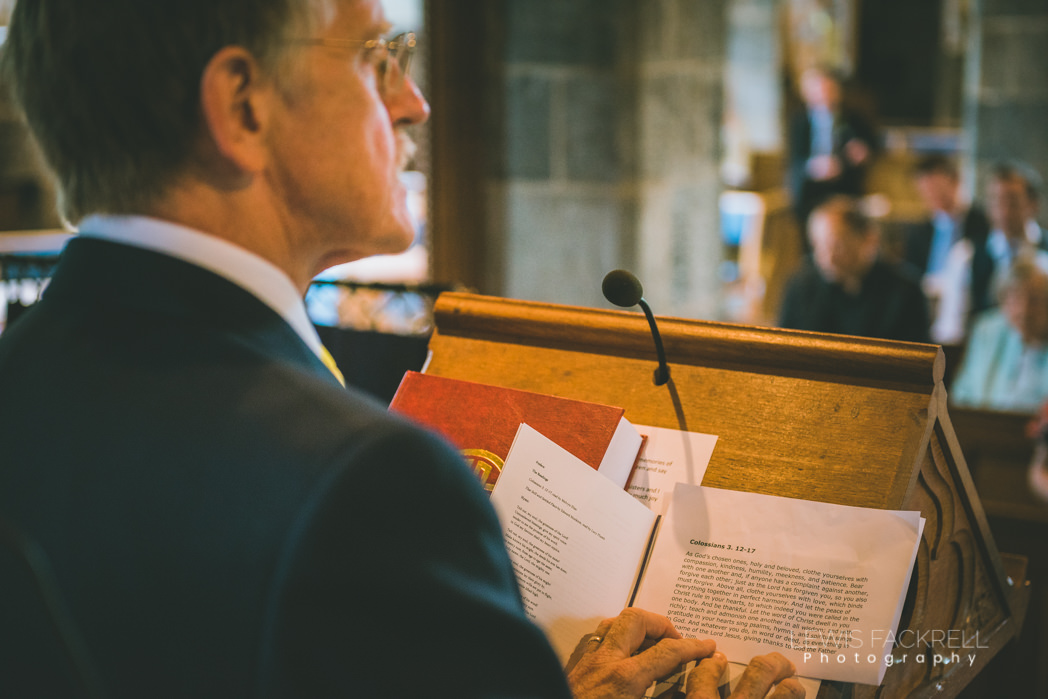 dad reading at service