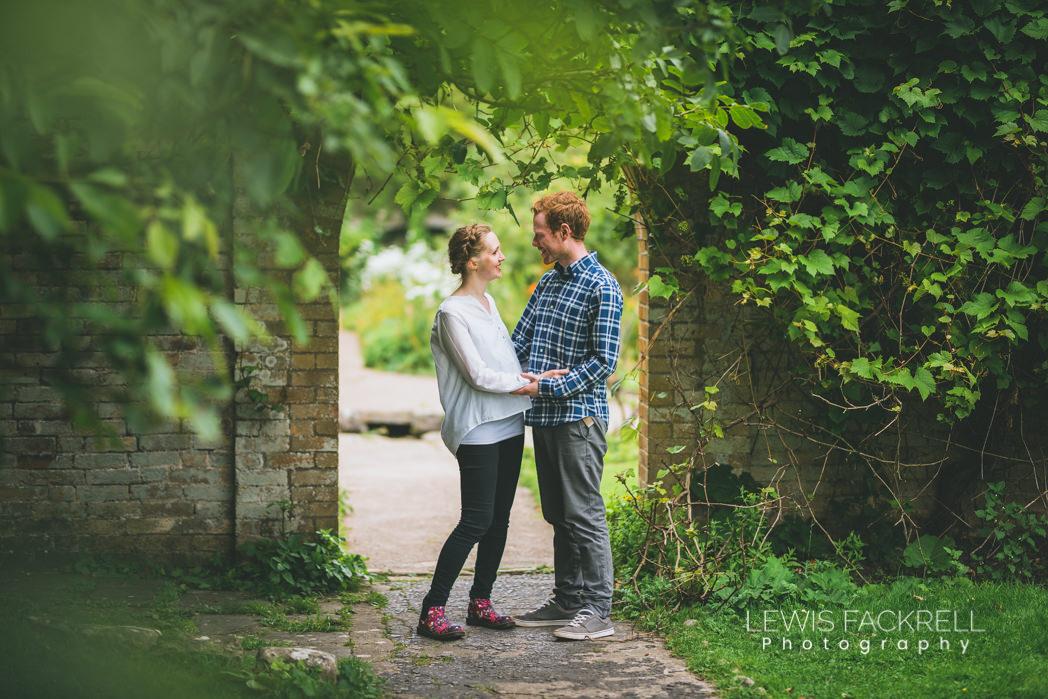pre-wedding photoshoot Ogmore wedding couple in archway