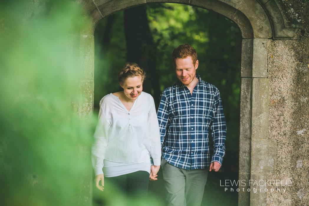 pre-wedding photoshoot Ogmore wedding couple walk through woodland