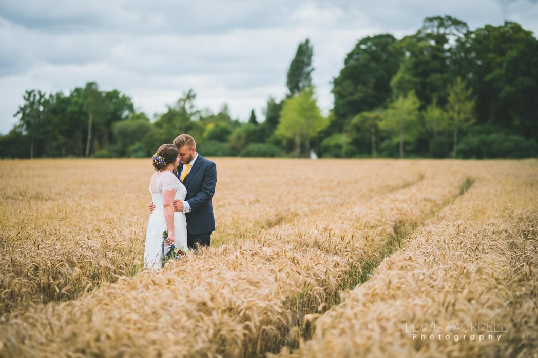 Jenners Barn wedding of Charlotte Steve in wheat field