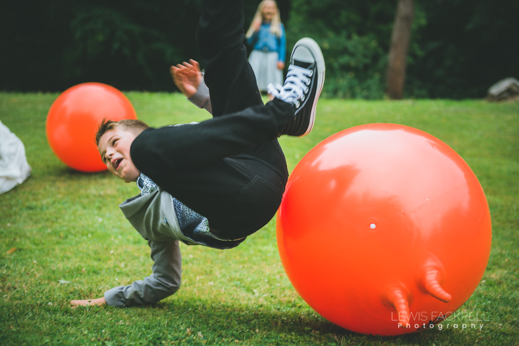 boy falls off space hopper