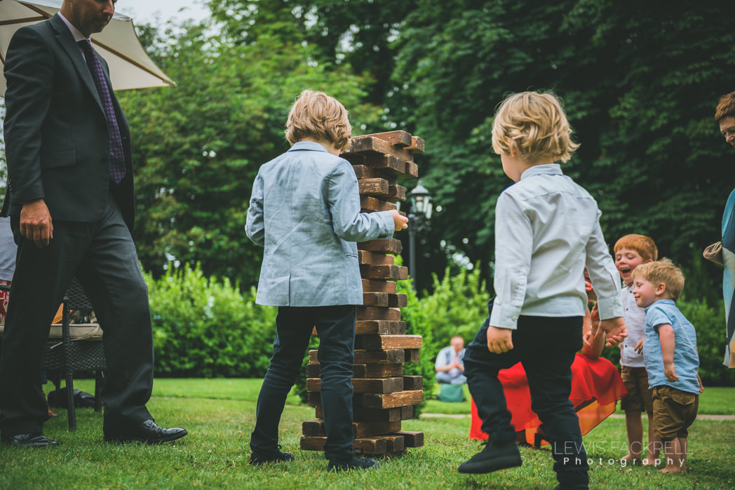 Young children playing garden games at wedding