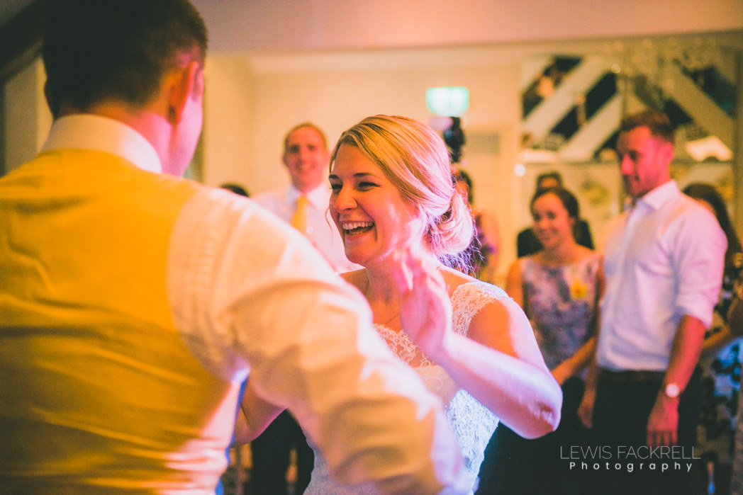 bride and groom ceilidh dancing