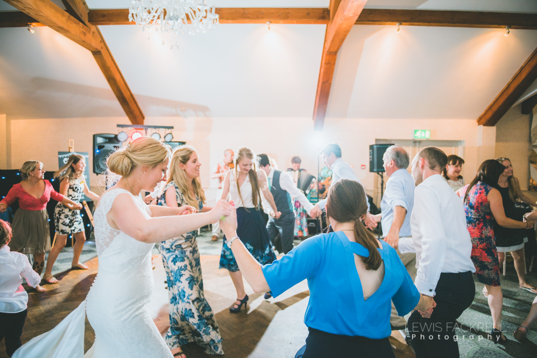 bride and guests dancing at wedding