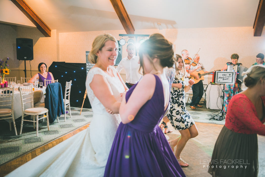 Dancing with bridesmaids at wedding