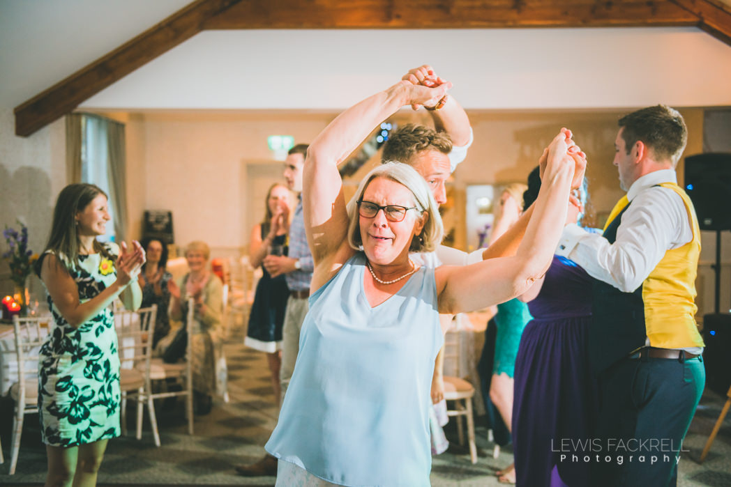 Ceilidh dancing with mother of the bride