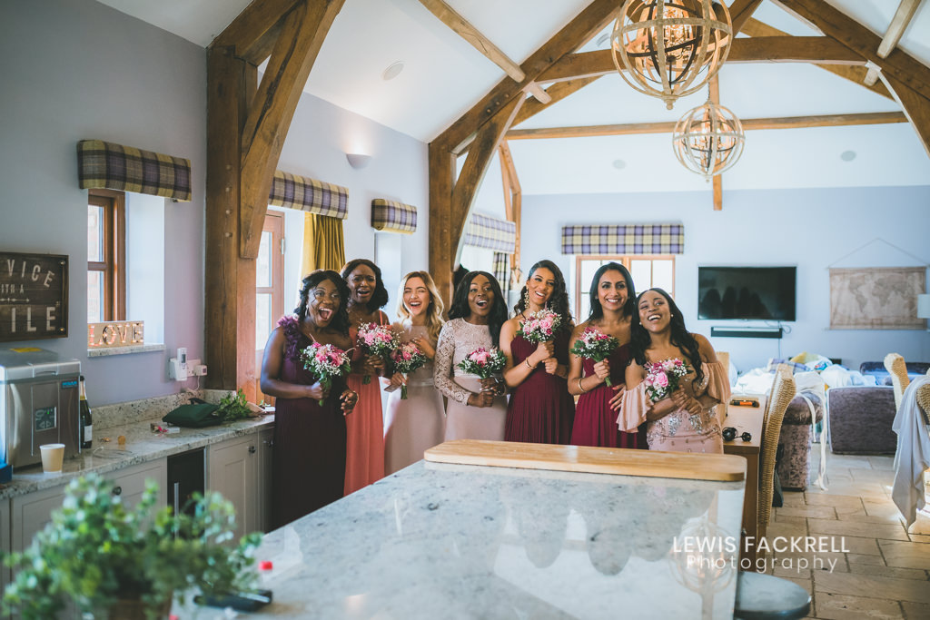 Wedding photography at Oldwalls with bridesmaids in Mulberry house