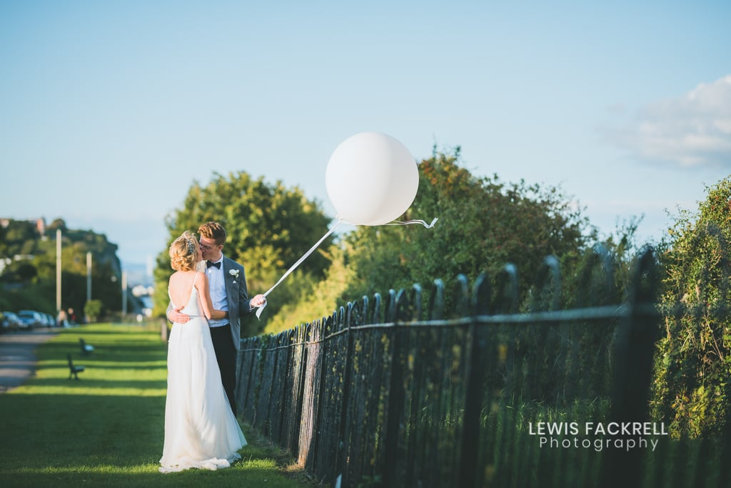 Wedding photography South Wales wedding photographer review 2017 bride and groom walking along penarth pier
