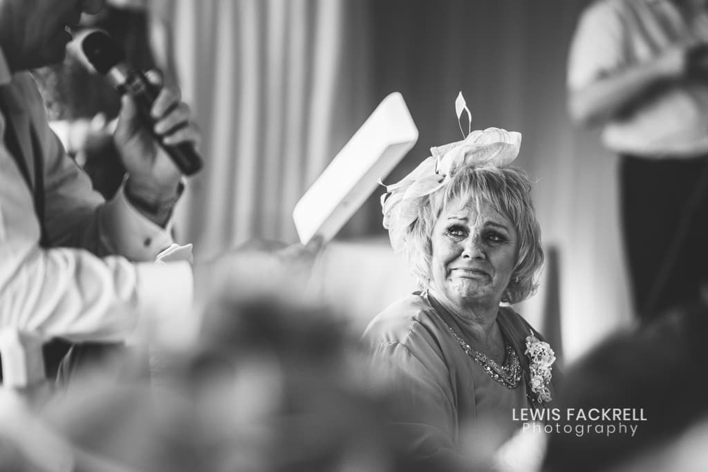 Wedding day planning of the speeches at oxwich bay in black and white