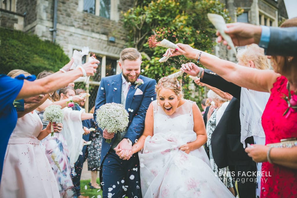 Wedding day planning with bride and groom during confetti run at miskin manor