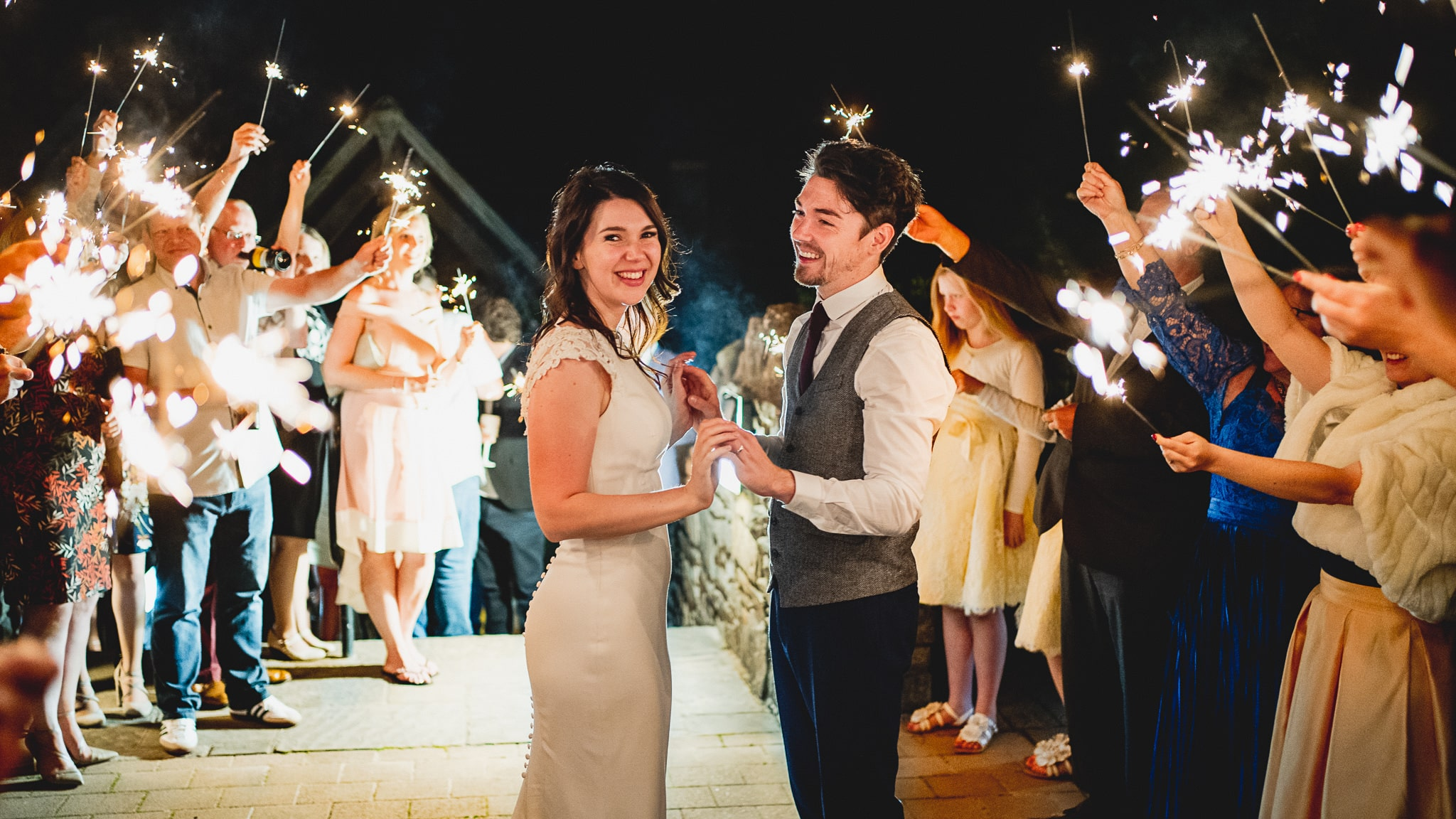 Canada Lodge & Lake wedding photography of sparklers with the bride and groom