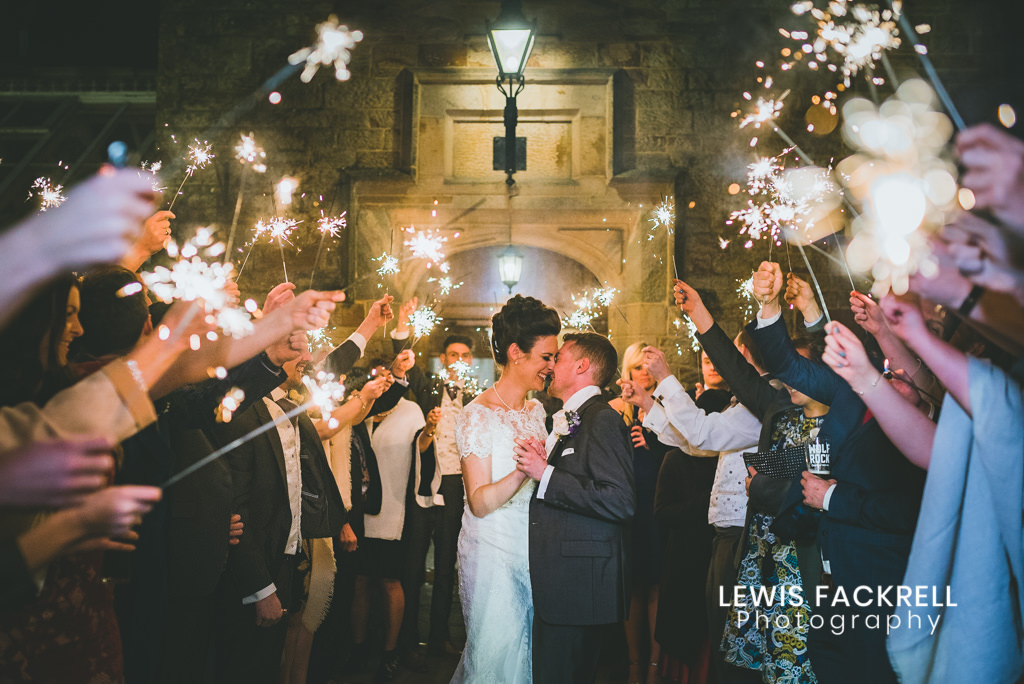 Wedding Sparklers at Bryngarw house with couple kissing