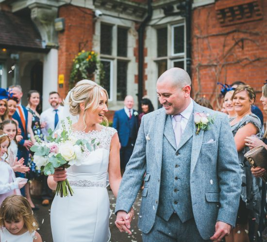 wedding photography and the confetti throwing at coed y mwstwr wedding venue