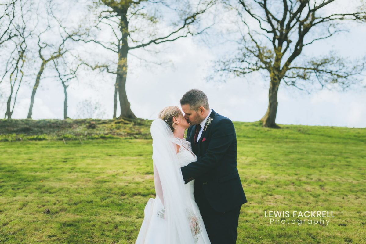Canada Lodge wedding photography of couple kissing on hill