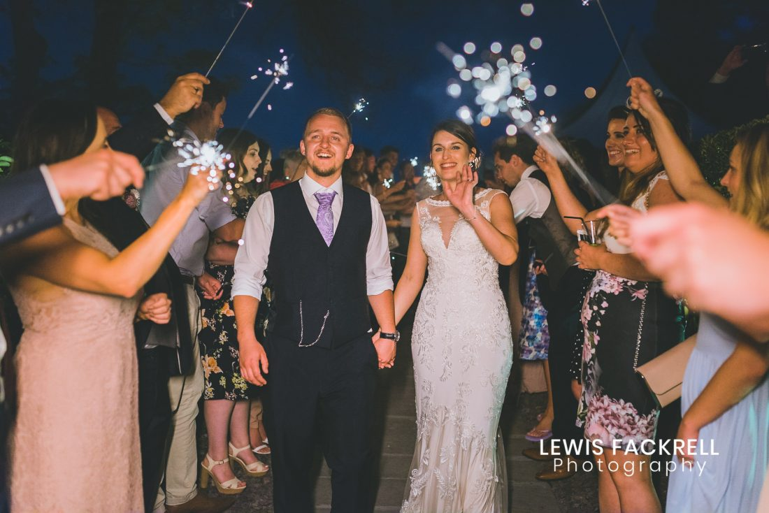 Oxwich Bay, Gower Wedding photography of couple with sparklers