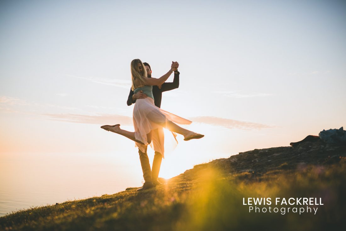 best wedding photography West Wales pre-wedding photography of couple dancing on the beach