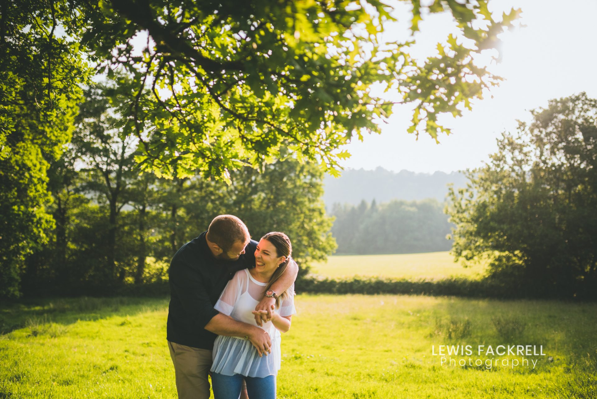 New House Hotel pre-wedding photography of couple in field at sunset