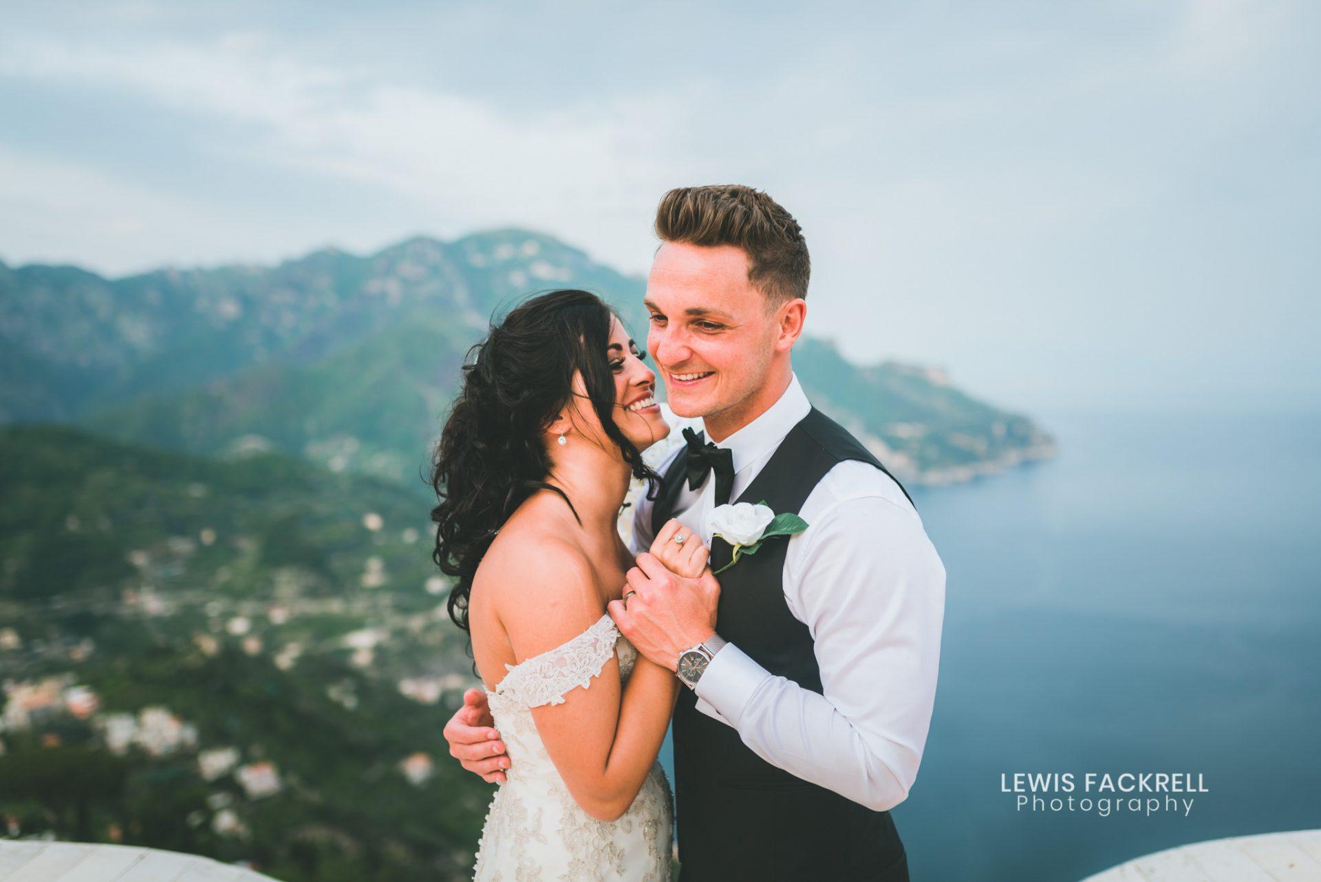 Couple stood on balcony at Ravello Destination wedding in Italy