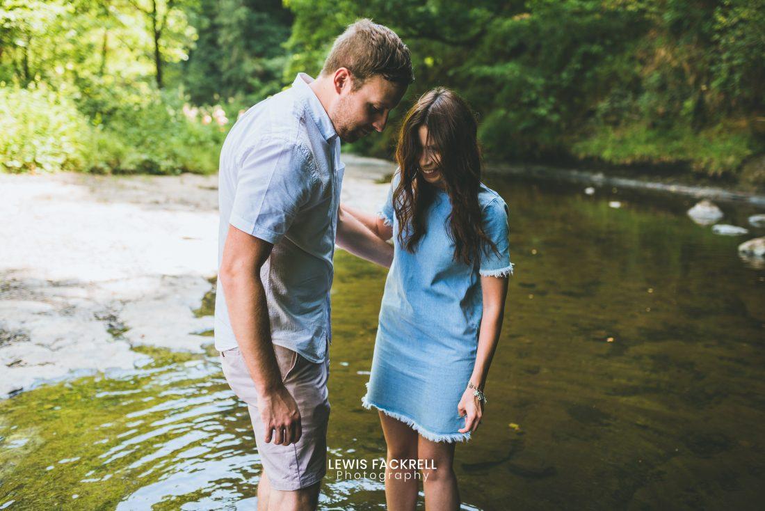 Brecon pre-wedding photo session of couple in the river at brecon