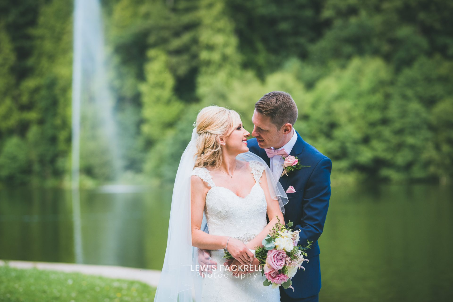 Canada lodge, cardiff wedding photography of couple holding each other by the lake