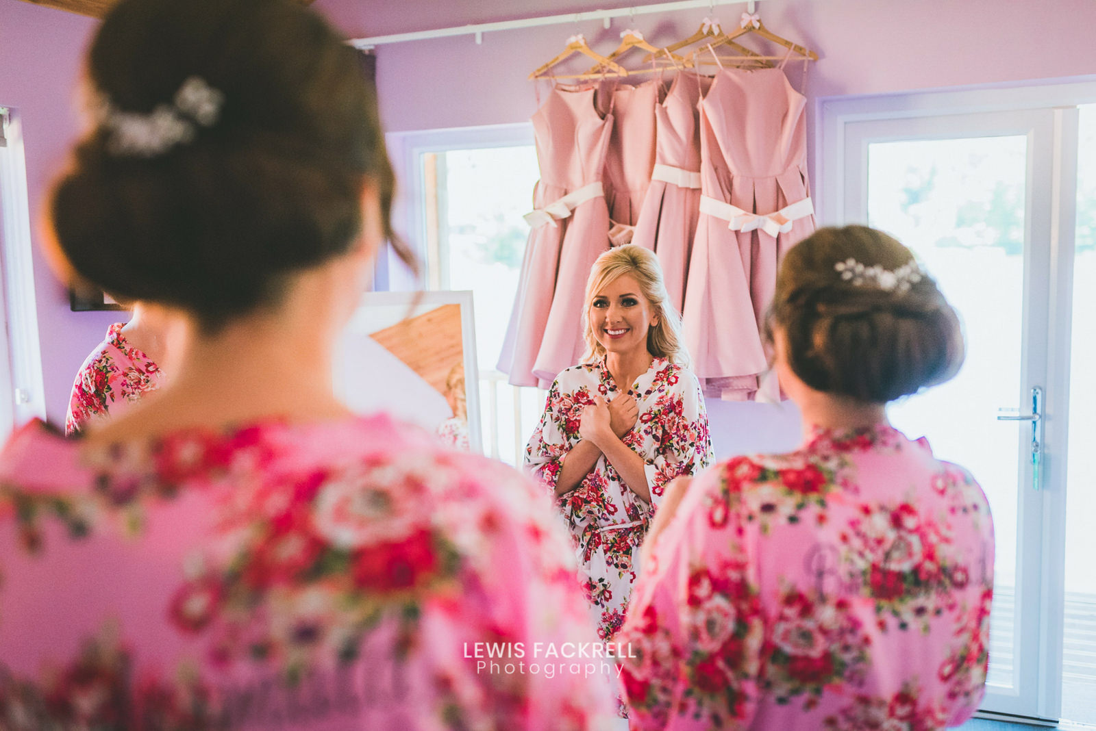 Bride and her bridesmaids excited at the lodges at canada lodge wedding venue