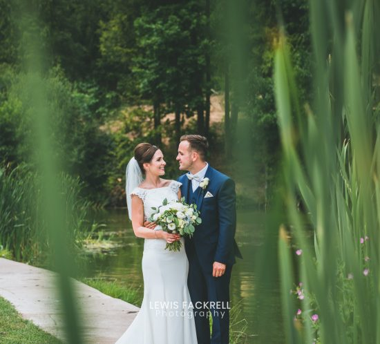 Canada lodge & lake wedding photography of couple during their portraits