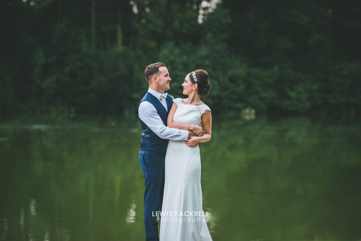 Canada lodge wedding photography of couple by the lake on their wedding day