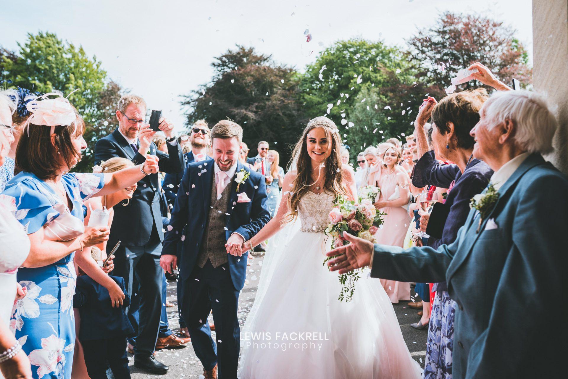 hensol castle wedding venue south wales of couple walking through confetti