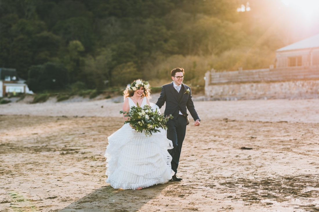 Oxwich Bay Hotel wedding photography in the gower with James and Eloise on the beach walking