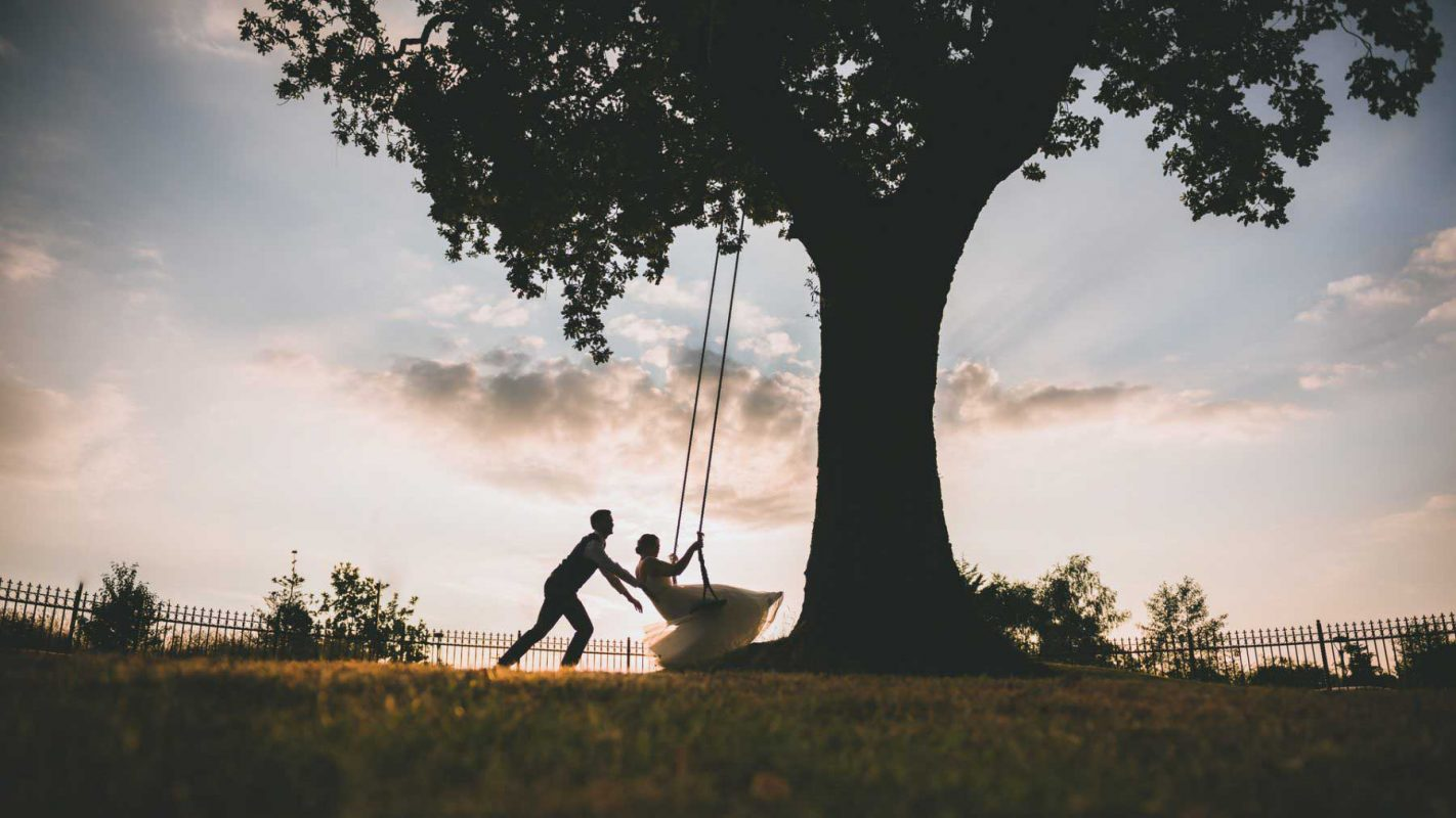 Cardiff wedding photographer south wales couple playing on swing at canada lodge