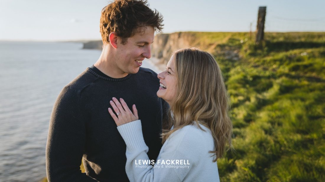 Couple holding each other for their wedding photography at Nash Point Lighthouse