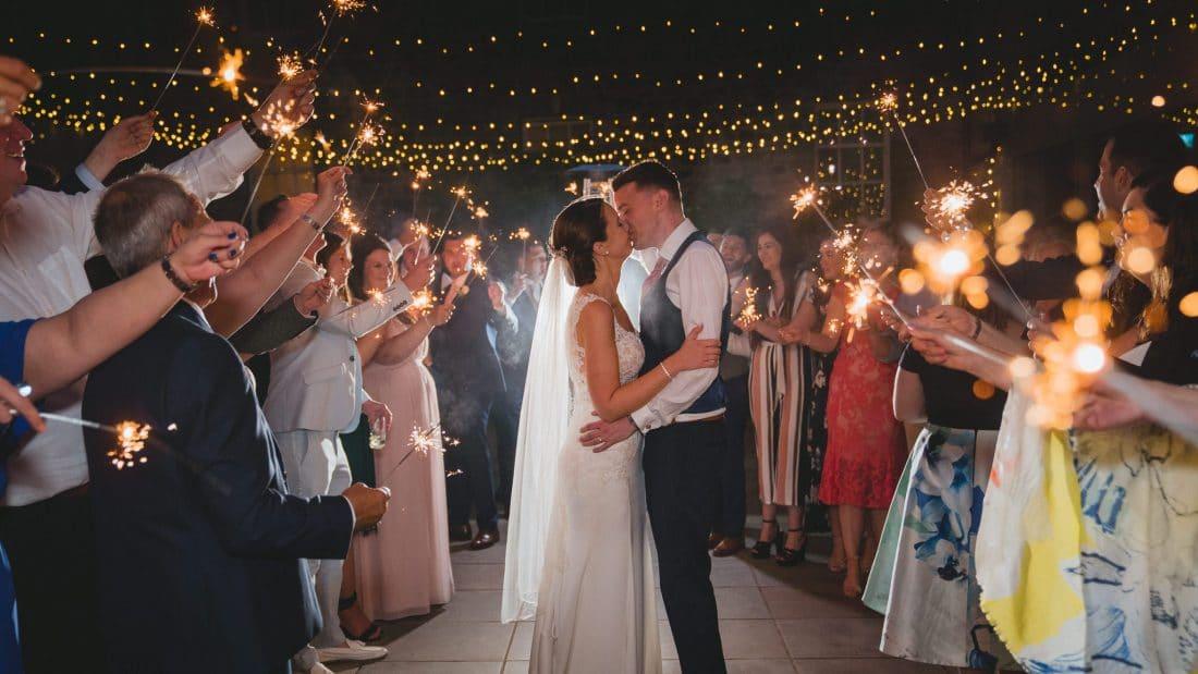 Hensol Castle wedding photographers of sparkler shot of bride and groom