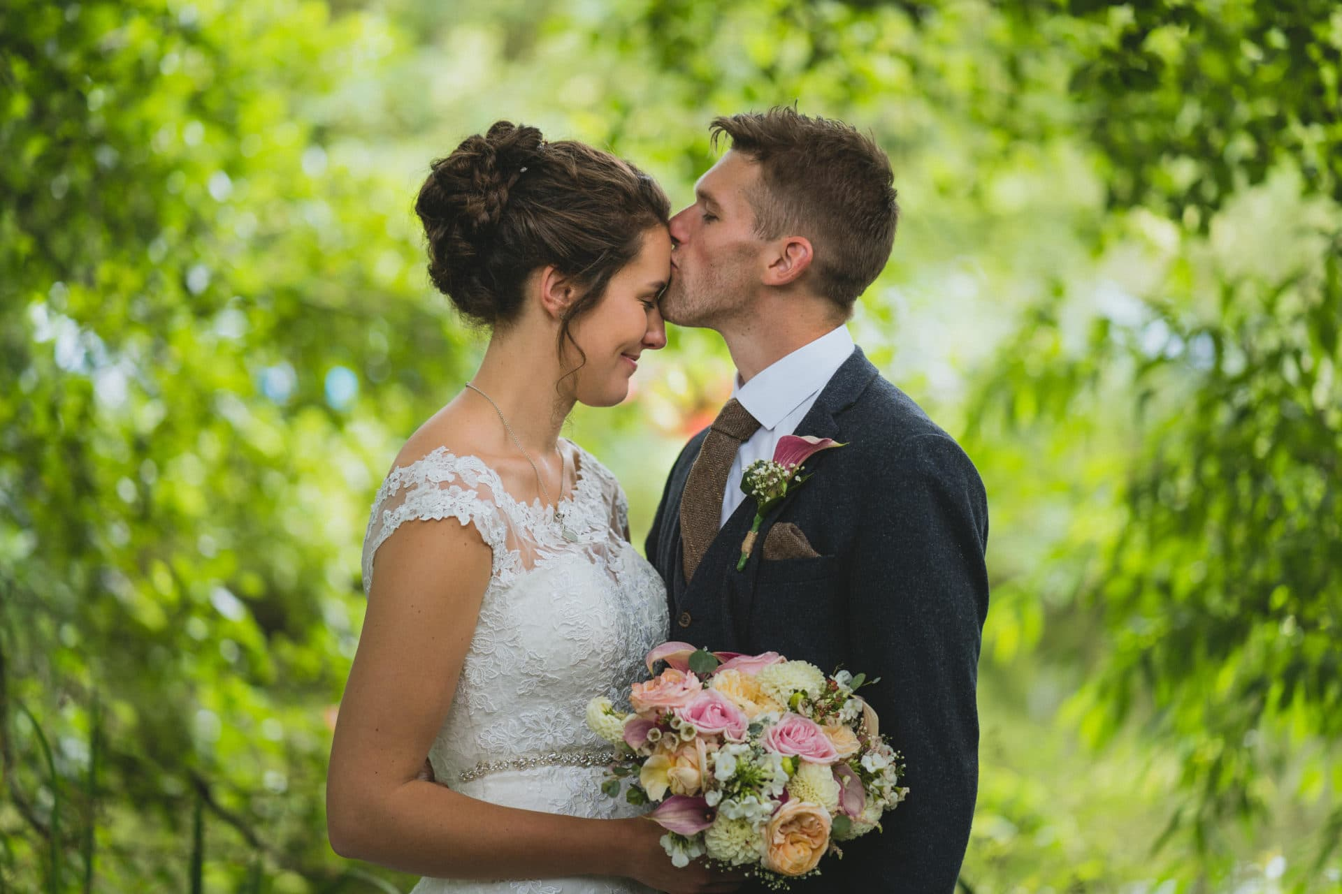 St Tewdrics house wedding photography of couple kissing in the garden