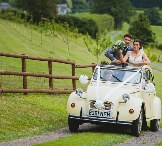 Sugar loaf barn wedding photography in South Wales of bride and groom laughing