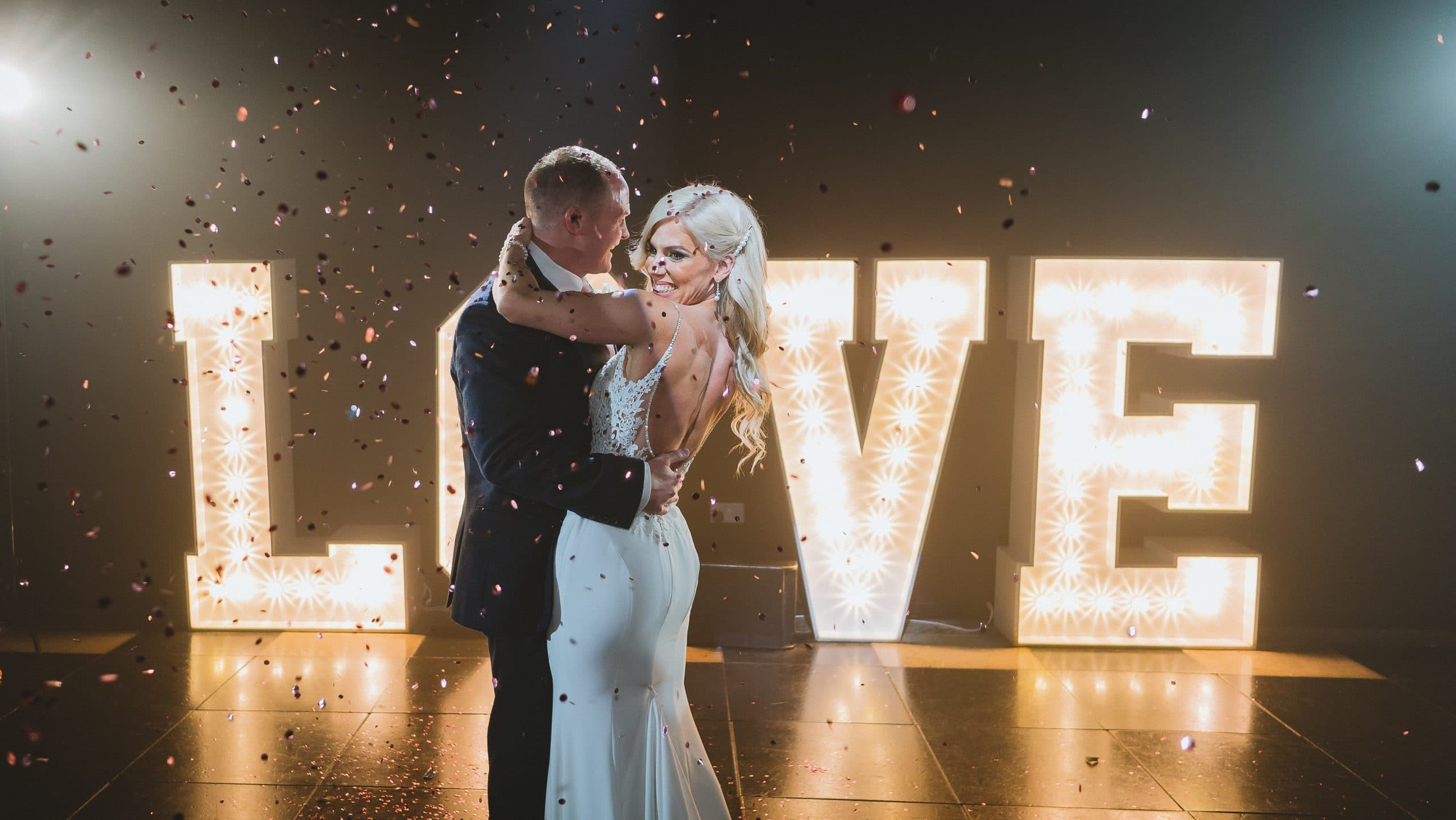 First dance of bride and groom for their wedding photography at Oldwalls & Gower collection with confetti canons