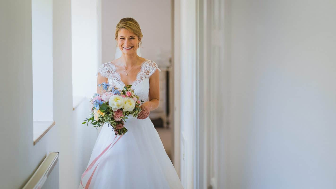 bride walking through house to the ceremony