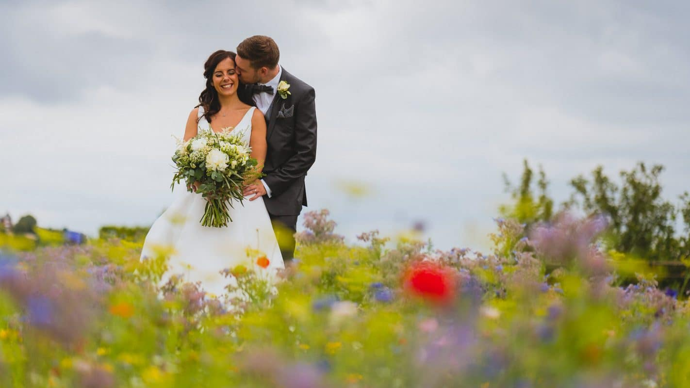 Wedding photography in Cardiff and cotswold of bride and groom during portraits kissing