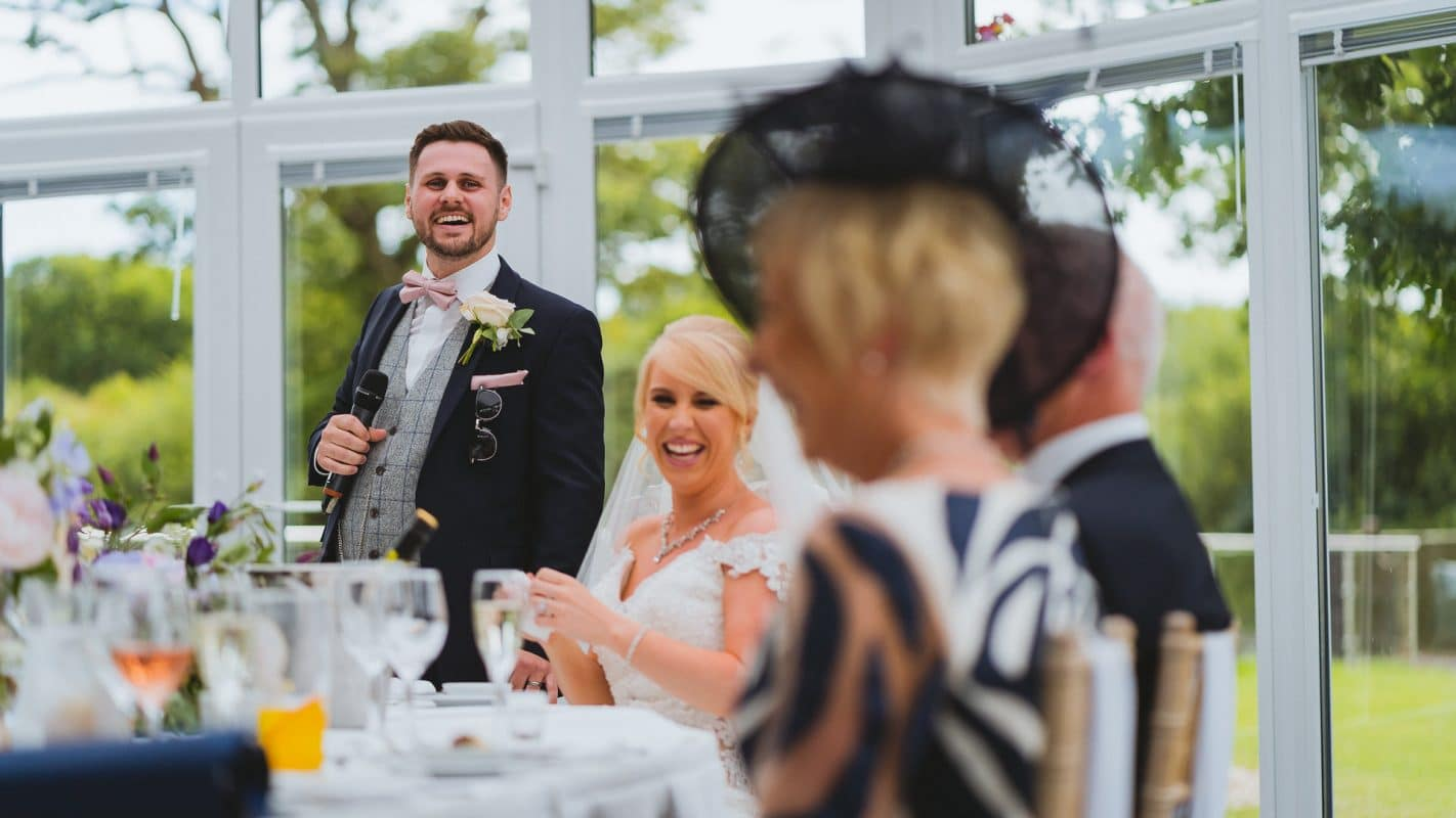 grooms speech making guests laugh