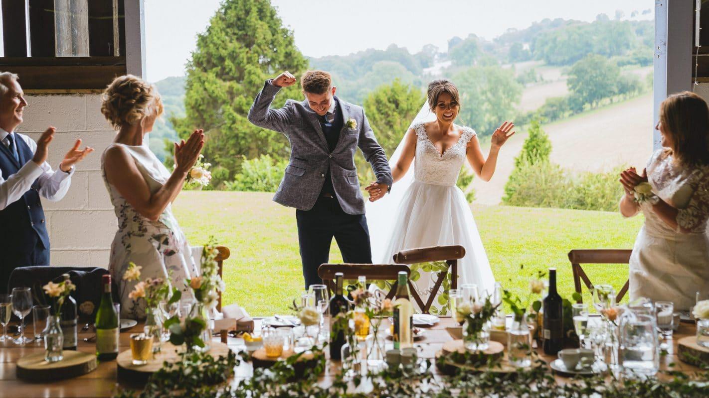 bride and groom enter their wedding reception at Sugarloaf barn