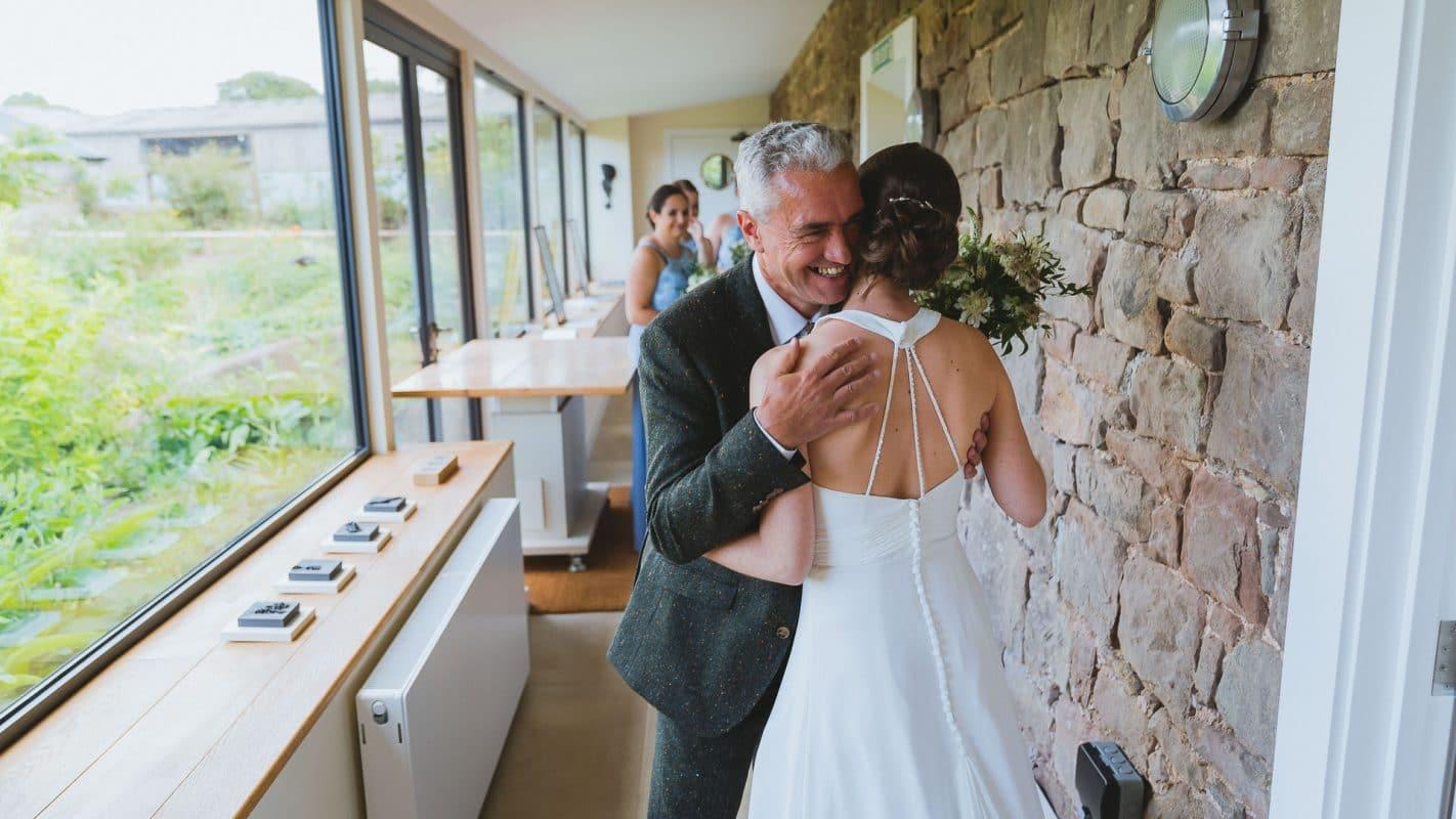 brides dad hugs bride before their ceremony