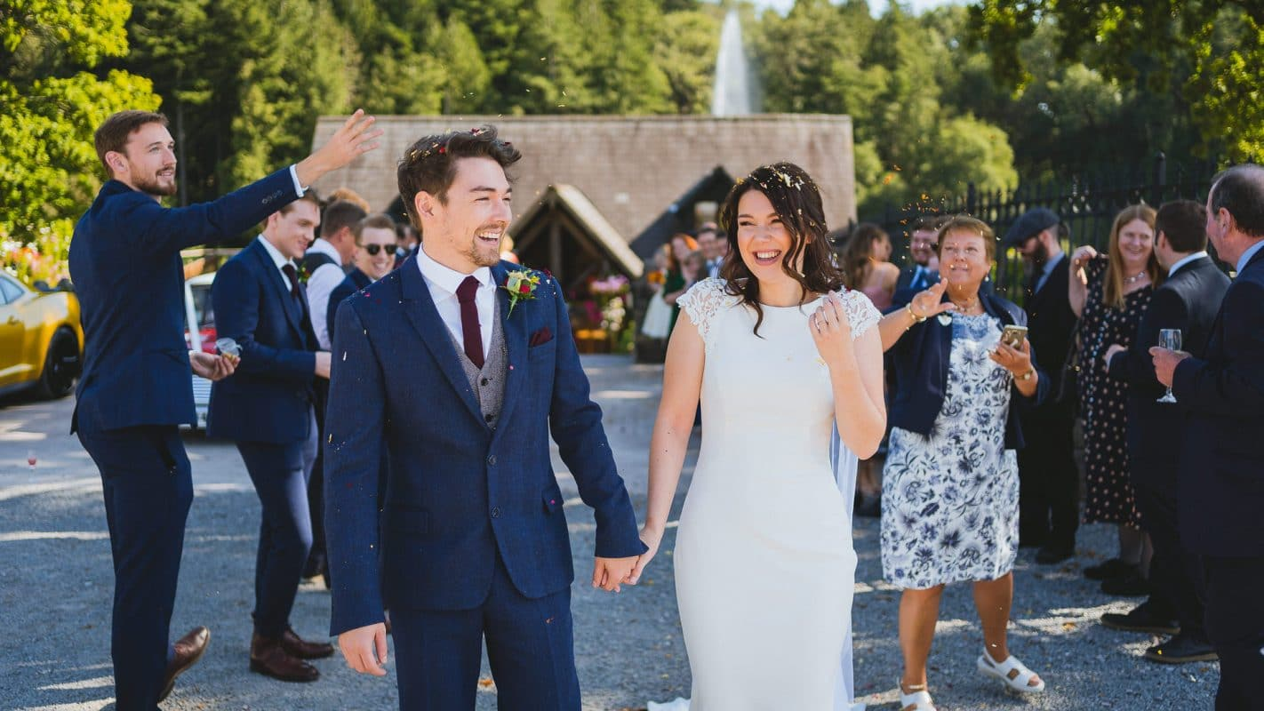 couple having confetti thrown over them at Canada lodge