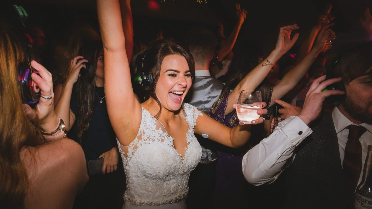 bride having a great time on the dance floor at her wedding