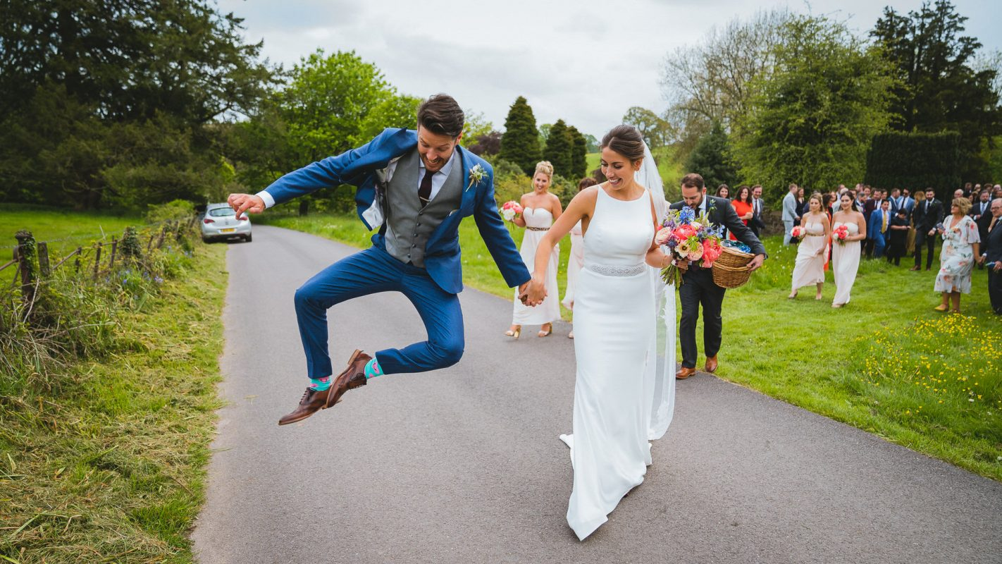 groom dancing in celebration